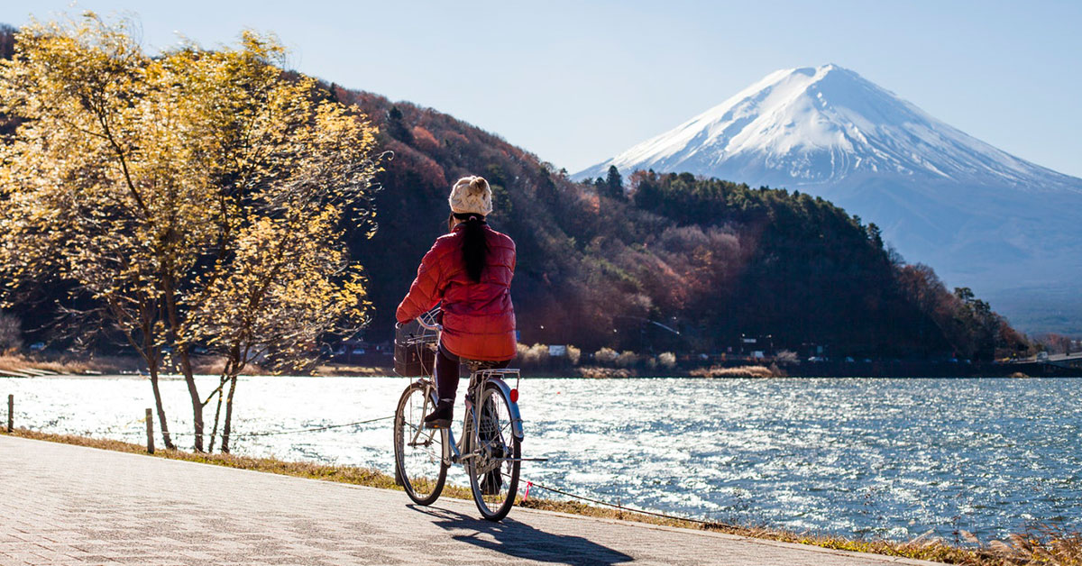 Lady cycling with Mount Fuji in the background